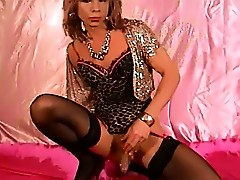 Slutty tranny Kim is wearing a gorgeous basque and fucking her ass with a monster toy.