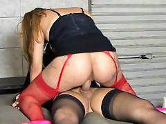 Red-stockinged girl having wild lesbo sex with a black-stockinged shemale