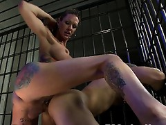 Morgan Bailey dressed in latex, fucking a guy in bondage, showering him in cum while he is tied up in pile driver.