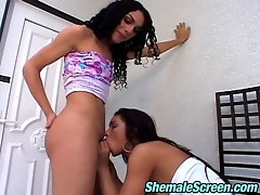 Vivacious shemale and her lustful next-door babe fucking right on the stool