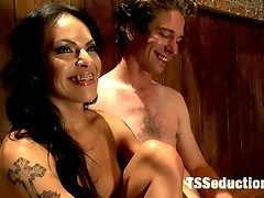 Ts Latina babe Foxxy, seduces a banker in her dirty bar. He sucks her cock and gets fucked in 4 different positions until Foxxy cums on his ass.