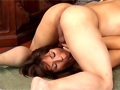 Well-shaped t-girl playing numbers game with hardcore finale on the floor