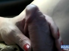 Irresistible transsexual playing with her cock while driving