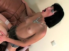 Freaky sissy in a blue summer dress sucking and taking up a strap-on dildo